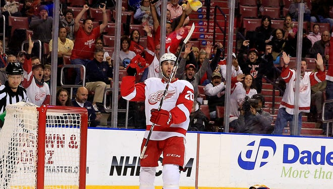 Red Wings left wing Drew Miller (20) reacts after a goal in the first period at BB&T Center.