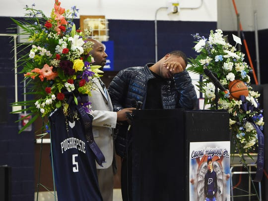 Akili Hill, 17, right, a student at Poughkeepsie High