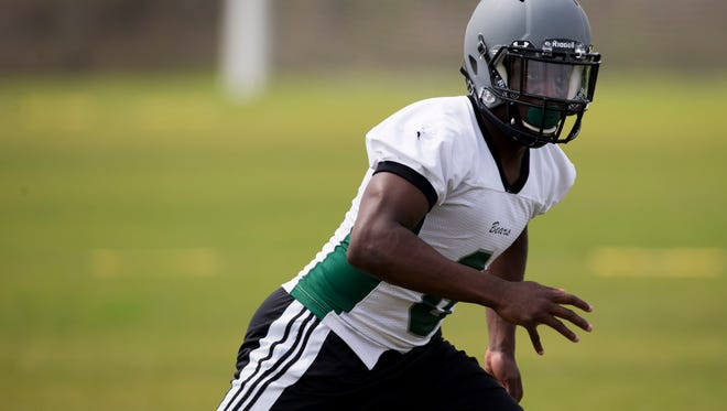 DeMarcus Townsend (8), a transfer from Gulf Coast High School, practices with his new teammates during Palmetto Ridge High School's first spring practice Monday, April 24, 2017 in Naples.