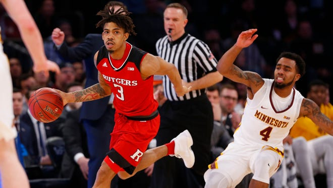 Feb 28, 2018; New York, NY, USA; Rutgers Scarlet Knights guard Corey Sanders (3) dribbles by Minnesota Golden Gophers guard Jamir Harris (4) during second half of game two of the 2018 Big Ten Tournament at Madison Square Garden.
