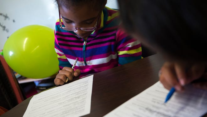Aaliyah Trent, 9, left, and Jayla Bartolomei, 9, fourth-graders at Fountain City Elementary School, work in a small group with their teacher a week before TNReady standardized tests are administered Thursday, April 13, 2017.