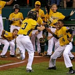 Goodlettsville's Tyler Jones (13) is welcomed by teammates after hitting a go-ahead solo home run in the seventh inning of a 4-2 win over Chula Vista, Calif., in the Little League World Series on Aug. 23, 2016.