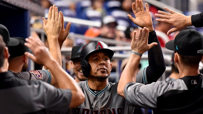 Arizona Diamondbacks center fielder Jon Jay (9) celebrates with teammates after scoring a run in the third inning against the Miami Marlins at Marlins Park.