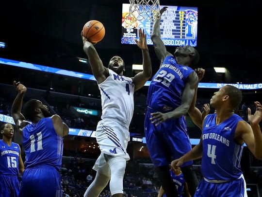 University of Memphis forward Raynere Thornton (4) shoots over Makur Puou (22) from New Orleans during the second half of their college basketball matchup at the FedExForum Tuesday night.