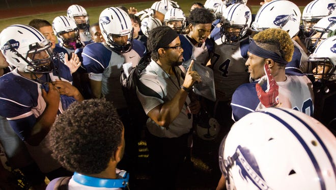Tempe High School coach  Brian Walker talks to his players after a win over Moon Valley during the 2014 season.