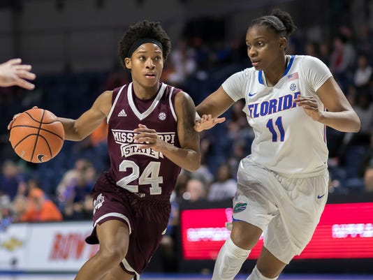 Mississippi State guard Jordan Danberry (24) drives past Florida guard Dyandria Anderson (11) during the second half of an NCAA college basketball game in Gainesville, Fla., Thursday, Feb. 8, 2018. (AP Photo/Ron Irby)
