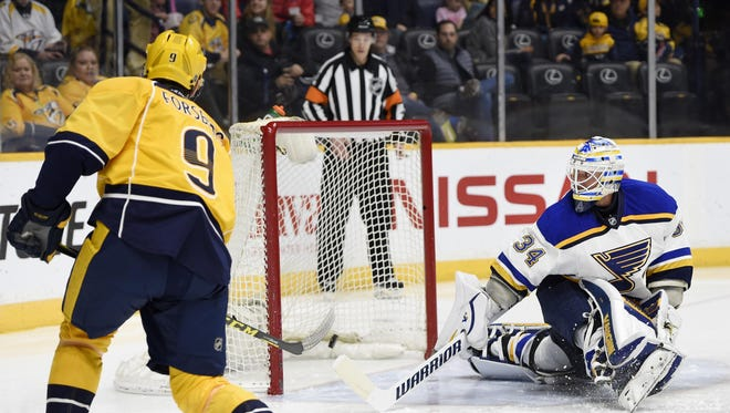 Predators center Filip Forsberg (9) scores his first goal of the second period Saturday.