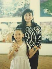 A young Stephanie Yu Lusk with her mother, artist Marlene Yu