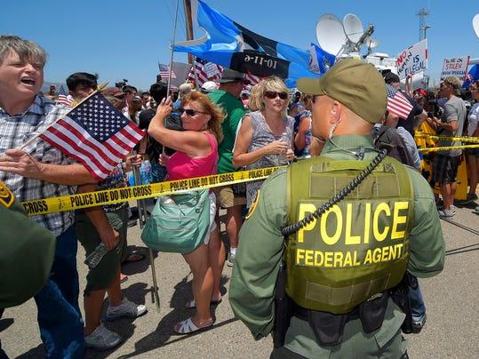 2014 214921571-Immigration_Overload_Flashpoint_CAMT106_WEB374101.jpg_2014070.jpg