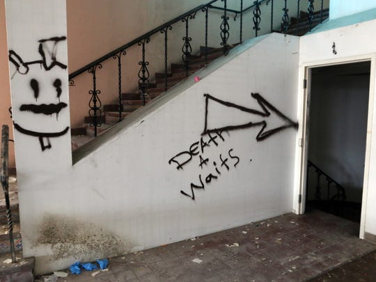 In this file photo from 2014, a spray-painted message