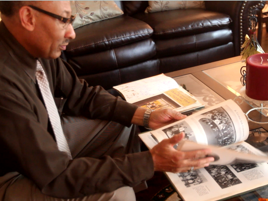 Clifford Adams flips through his class of '69 yearbook from Clarksville High School in January 2017. He was one of the first black students to desegregate schools in Clarksville, Tennessee.
