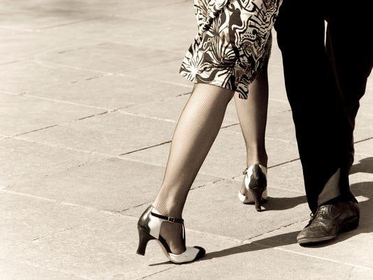 Tango dancers with sepia tones