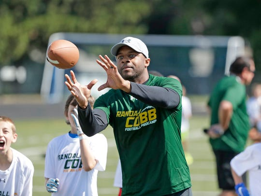 Green Bay Packers wide receiver Randall Cobb catches a pass from a camper July 18 during the Randall Cobb Football ProCamp at Notre Dame Academy in Green Bay.