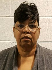 Michelle Reed, 61, of Novi faces five counts of felony
