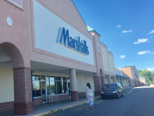 A shopper enters the Marshalls store at Deptford Crossing