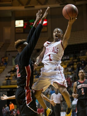 Lee's Kendarius Hartwell lays the ball up around Central-Phenix City's Tionne Williams during the Class 7A Central Region Championship on Tuesday, Feb. 17, 2015, at the Dunn-Oliver Acadome in Montgomery, Ala.