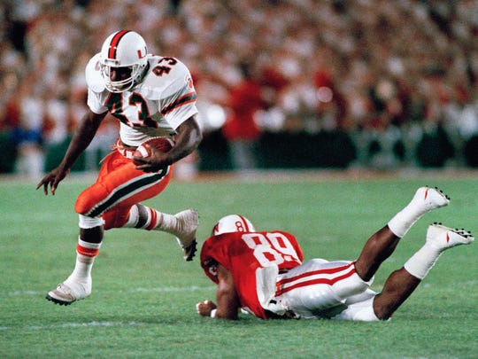 University of Miami fullback Cleveland Gary (left) outruns Nebraska's linebacker Broderick Thomas in the first quarter of the 55th annual Orange Bowl Classic on Jan. 2, 1989.