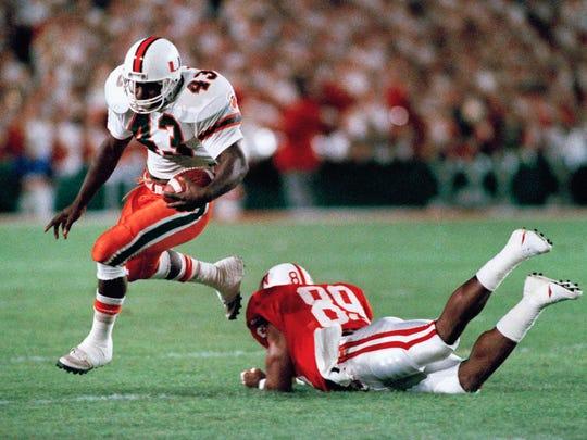 University of Miami fullback Cleveland Gary (left)