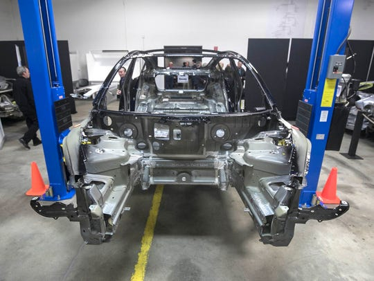 A stripped-down version of a Tesla Model 3 was part of a reverse engineering event at Munro & Associates in Auburn Hills on Wednesday,  April 25, 2018.