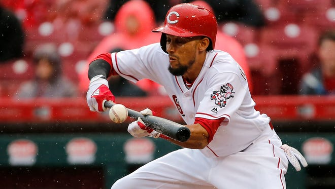 Cincinnati Reds center fielder Billy Hamilton (6) tries to lay down a bunt during the National League baseball game between the Philadelphia Phillies and the Cincinnati Reds, Monday, April 3, 2017, at Great American Ball Park in Cincinnati.