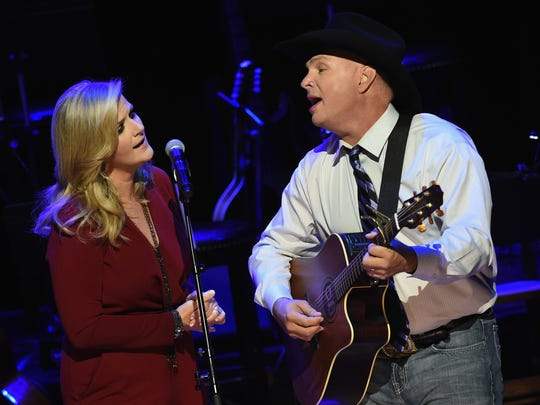Trisha Yearwood and Garth Brooks perform during The