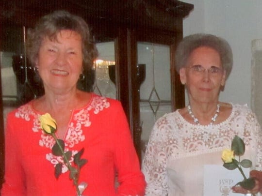 Preceptor Iota Omicron Chapter presented the Silver Circle Ritual signifying 25 years in Beta Sigma Phi to Judy Robinson, left, and Patty Englert.