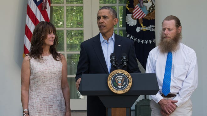 President Barack Obama makes a statement May 31 about the release of Sgt. Bowe Bergdahl as his parents, Jani and Bob Bergdahl, listen.