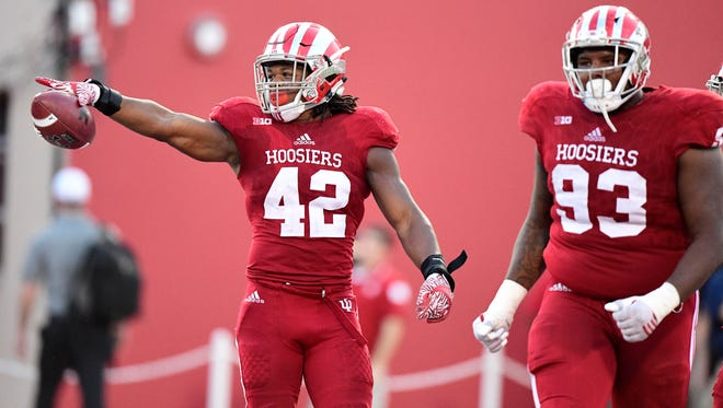 IU's Marcelino Ball (42) points to the fans after recovering a fumble during the second half of a game at Memorial Stadium.