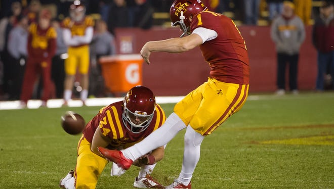 Iowa State Cyclones place-kicker Cole Netten (1) attempts a kick against the Texas Tech Red Raiders in 2014.