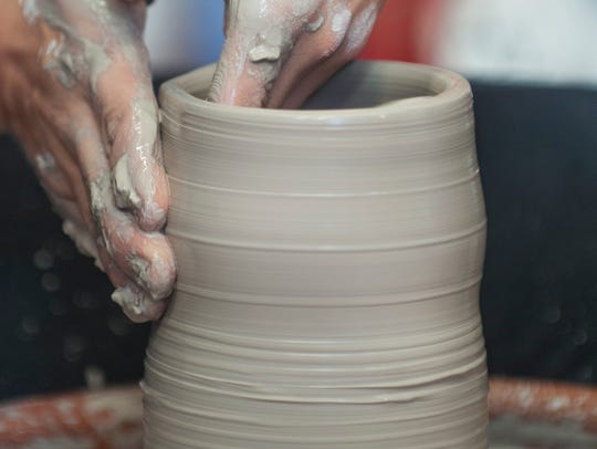 Max Brooks of Collingswood creates a piece of pottery