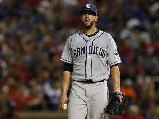 Padres' pitcher James Shields looks exasperated between pitches during a recent game. The Padres' offseason moves did not pay dividends in the first half.