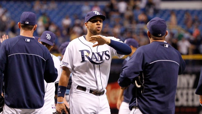 Tampa Bay Rays first baseman James Loney (21) is congratulated by teammates after they beat the  Milwaukee Brewers at Tropicana Field.