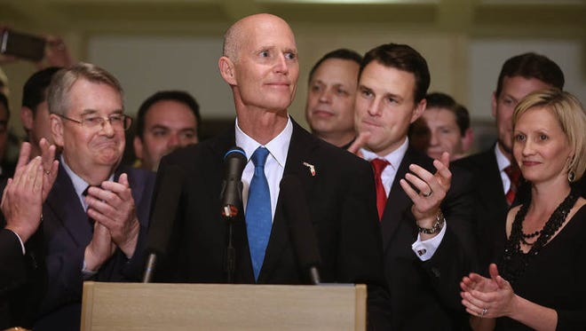Florida Governor Rick Scott waits for the  applause to die down during Friday's closing of the Florida Legislature during the sine die ceremony.