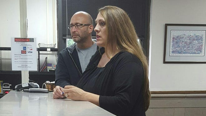 APD detectives Brian Evans and Kim Mager file the charges Ashland County Clerk of Courts office.
