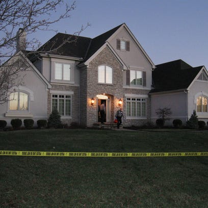 Mason police leave the home of Timothy and Susan Sparks.