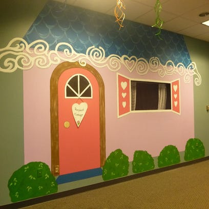 A newly painted puppet show wall is indicative of the