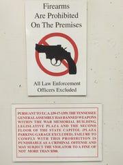 Gun sign inside the Legislative Plaza office building