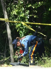 Authorities investigating a dead body found in Rockaway