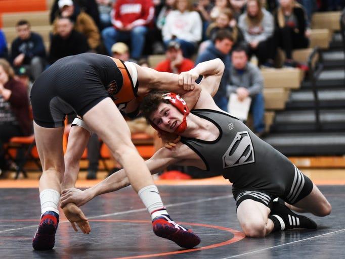 Sheridan's Nick Ranalli takes a shot against New Lexington's