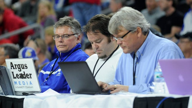 Mick Garry, Matt Zimmer and Stu Whitney cover the SDSU and USD during the Summit League Tournament semifinal game on Monday, March 9, 2015, at the Denny Sanford Premier Center in Sioux Falls, S.D.