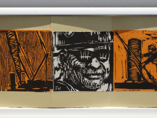 Some of the woodcut artwork featuring the men and women