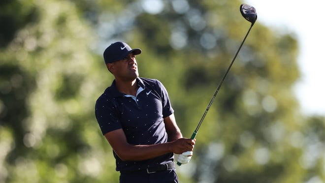 Tony Finau watches his tee shot on the 11th hole during the first round of the 3M Open golf tournament at TPC Twin Cities on Thursday. Finau is two shots off the lead.