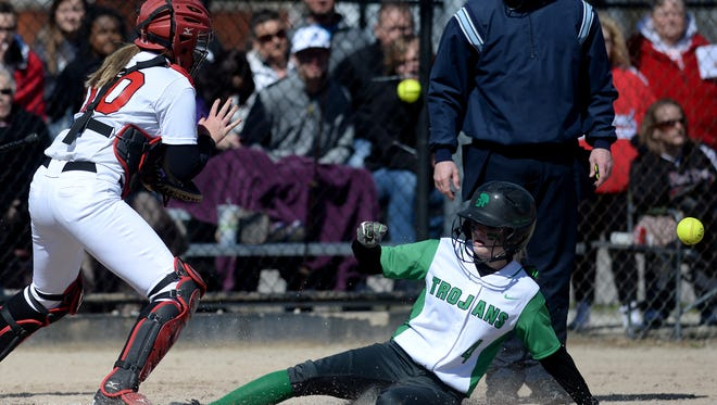Richmond's Brooklyn Vickers waits on the ball as New Castle's Mariah Nicholson slides across the plate during a softball game Saturday, March 26, 2016 at Richmond.
