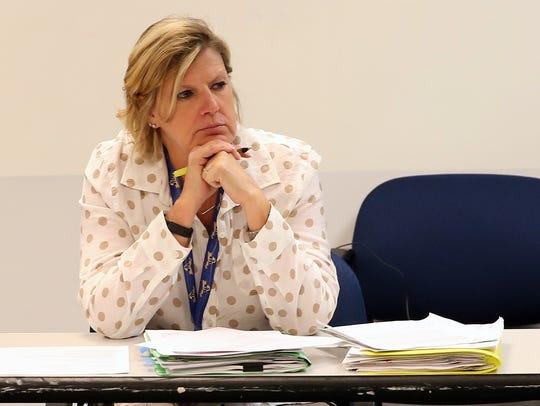 Section 1 Executive Director Jennifer Simmons, runs