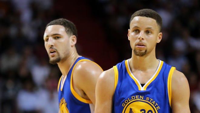 Feb 24, 2016; Miami, FL, USA; Golden State Warriors guard Stephen Curry (right) and Warriors guard Klay Thompson (left) looks on during the second half against the Miami Heat at American Airlines Arena. Mandatory Credit: Steve Mitchell-USA TODAY Sports