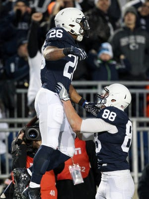 Penn State Nittany Lions running back Saquon Barkley (26) celebrates with tight end Mike Gesicki.