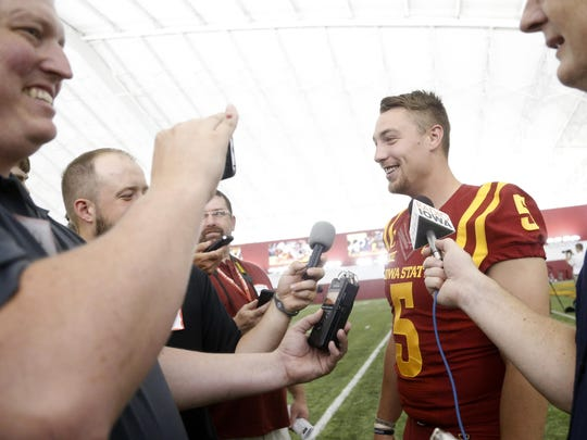 Iowa State linebacker Joel Lanning talks with members of the media while wearing teammate Allen Lazard's jersey during the Iowa State Football Media Day on Thursday at the Bergstrom Indoor Facility in Ames.