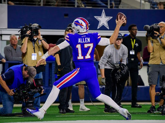 Nov 28, 2019; Arlington, TX, USA; Buffalo Bills quarterback Josh Allen (17) spikes the ball after he runs for a touchdown against the Dallas Cowboys during the game at AT&T Stadium. Mandatory Credit: Jerome Miron-USA TODAY Sports