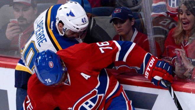 Maxim Lapierre, left, checking Montreal Canadiens defenseman P.K. Subban, is heading to the Pittsburgh Penguins.