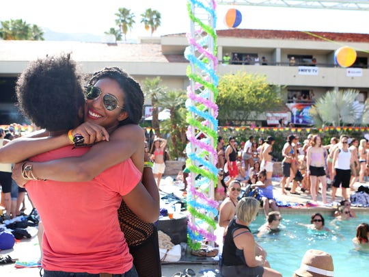 The Desert Sun Jynarra Brinson, left, and Adrienne Jordan, both of Los Angeles, hug after dancing poolside during The Dinah 2015 pool party at the Hilton Palm Springs in Palm Springs on Saturday, April 4, 2015.